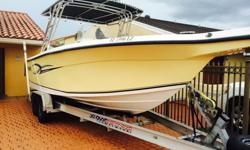2003-28 ft Angler 2700 Center Console fishing boat with dual axle aluminum trailer. Fighting Lady Yellow. Great condition. Twin Yamaha 200hp 4 stroke engines with 580 hours total. GPS, fish finder, large Bimini top. Live well, fish cleaning station,