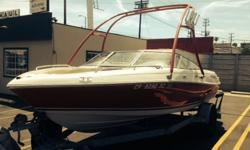 Stock Number: 715482. Bimini Top, depth finder, swim deck with fold down ladder, Competition Wake Board Tower, Vinyl floor with snap in carpet, ski storage, anchor, buoy, am/fm cd player and speakers. 210hp Volvo Penta 5.0L, max speed 65, 8? beam,