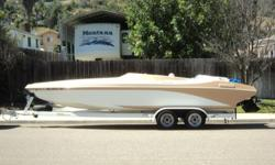 24' Cheetah Stiletto tunnel boat, day cruiser. Mercruiser 6.2 ltr 320 HP, Bravo 1 outdrive with 4 blade stainless prop. Tandem trailer with disc brakes. Fold down swim step. Bimini top. 228 hours on engine. Original owner. Great condition. Never been in