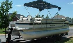 2003 Fisher 22 FT Deluxe Fish pontoon boat equipped with a 2003 Honda 90 HP Four Stroke engine and matching tandem trailer. This is a very clean boat that offers the versatility of cruising, tubing, skiing or fishing. The interior is really sharp with all
