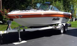 This Malibu Sunsetter 23 XTi is a pristine personal boat currently in water of Lake George at owners personal residence. This boat has been meticulously maintained by ASE certified owner since new. Hot Orange and White exterior and White interior with