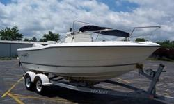 2003 Sea Boss 2100 CC 21FT Fishing Boat, 150 johnson engine, piranah 4 fishfinder, 7 person 1050lb capacity, cooler, bimini top, lots of storage, 2 livewells, very nice clean boat, lots of storage, very deep sturdy boat, venture alumnium trailer,