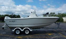 2003 Sea Boss 2100 CC 21FT Fishing Boat, 150 johnson engine, piranah 4 fishfinder, 7 person 1050lb capacity, cooler, bimini top, lots of storage, 2 livewells, very nice clean boat, lots of storage, very deep sturdy boat, venture alumnium trailer,