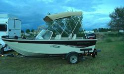 This is an aluminum Starcraft fishing boat it comes with the EZ Load trailer, MinnKota 24v 65 pound thrust tolling motor, Humminbird fishfinder 535, kenwood cd player, live wells in front and back, 75 hp Murcury outboard motor. This boat has been kept in