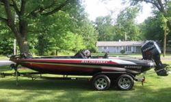 2003 Stratos 21XL Pro Star Bass Boat.2003 Evinrude 225 HP RAM FICHT Injection.2003 Stratos Dual Axle Trailer with surge brakes and lighted logos.This is an awesome bass boat. The boat is a dual console 21 foot rig with an all composite fiberglass hull.