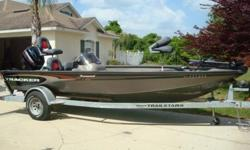 """THIS 2003 TRACKER V-18 TOURNAMENT LOOKS MORE LIKE A 2008 THAN A 2003. SHE IS IN ABOVE AVERAGE CONDITION FOR THE YEAR. THE TRACKER TOURNAMENT V-18 FISHING BOAT IS A COMPETITION CONTENDER FROM THE WORK """"GO"""". THANKS TO THE WIDE BEAM, THIS HULL COMBINES THE"""