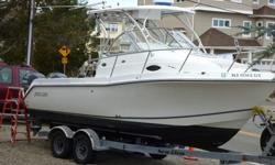 The boat is a Deep V and is equipped with Standup cabin, cabin lights, dock power, AC/DC refrigerator, cabin sink,, V-berth with table, microwave, AC power outlets, Digital gauges, Hydraulic Steering, Trim tabs, DC outlets, battery charger, battery