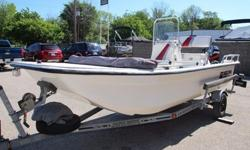 If you like the idea of a small, easy to handle, center console with plenty of room for you and your gear, then take a look at this super clean, 2004 Carolina Skiff 1655DLX. The center console provides plenty of walk around room throughout the boat, while