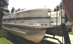 Has the bigger diameter pontoons and rides very smooth. 2006 60hp Mercury Bigfoot just serviced and ready to go. Trailer is included! It is a tandem axle with surge brakes. This party barge is ready to be in the water this weekend. The interior needs some
