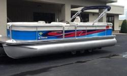 Convenience Features Bimini, 10 ft. (1.25 in. frame with SST quick release) Cleats, stainless steel Ladder, 3-step fold down (stern) Table, with drink holders (see floorplans for placement) Windscreen, removable Gauges Gauges, Analog: Tach Trim Fuel