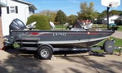 2004 Lund Mr.Pike with 115hp Yamaha 4stroke and trail master trailer. Duel live wells/bait tank. Plenty of storage with rod locker. 24V MinnKota 65lb thrust foot controlled Trolling motor. Duel Fish Finders, Eagle 320c at bow and Hummingbird at driver
