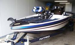 2004 NITRO NX882 18' BASS BOAT WITH A 150 HORSE MERCURY MOTOR. RED, WHITE, AND BLUE. POWER TRIM, FOOT & HAND THROTTLES . EVINRUDE TROLLING MOTOR FORWARD.HUMMINGBIRD FISH FINDER, ALL THE BELLS AND WHISLES A BASS BOAT SHOUD HAVE.THIS IS BOAT MOTOR AND