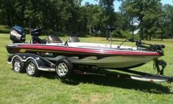 This 2004 Ranger Commanche 521VX bass boat is in like-new condition. It's fully equipped with a 250hp Evinrude motor with low, low hours and a stainless steel prop, 101 lb. thrust Minn Kota trolling motor with recessed foot control, two (2) Garmin