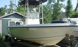 2004 Sailfish 2100 Center Console Bay Boat, 2004 Yamaha 150 Hp Two Stroke with 247 Hours, 2004 Aluminum Magic Tilt Trailer. Seastar Hydraulic Steering.T-Top with Spreader Lights.Minn Kota 74lbs trolling motor with Minn Kota onboard charger.Swim