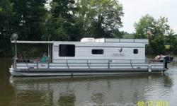Move in and water ready. Everything you need is included with the boat all you need to do is start enjoying it. 2004 Utopia Houseboat 40 x 15- no trailer2014 25 hp Big Foot motor with power lift controls on throttle,3 year warranty and title- only 1/2