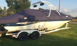 Stock Number: 720555. 2 covers, table, Wake Board Tower, External speakers, Ipod port, CD changer, XM Stereo, Cooler, two swim ladders, swim platform, PA system, Removable Carpet, seating for 14. Great condition! Barely used. Catelog cover boat, fully