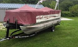 with low hours, this pontoon boat is ready to go. She is nicely equipped with depth sounder, livewell, dual pedestal fishing seats on the bow with rod holders, extra density foam seat cushions, bimini top, tandem axle trailer and full boat cover. Helm has