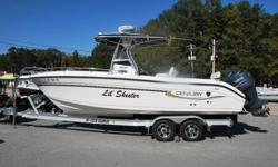 """2005 26 foot Century Center Console outboard Fishing boat for sale complete with twin Yamaha 200 hp fuel injected motors with only 220 hours, 2010 aluminum """"I"""" beam tandem axle trailer with brakes and spare and way way more. The boat has an awesome """"T"""""""