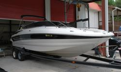 This awesome Crownline 24 foot deck boat is in great condition inside and out with only 392 HOURS on it. The boat comes LOADED with huge bimini top, snap on covers, snap in Berber carpet, gorgeous two tone interior, full instrumentation including depth