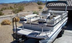 2005 Fisher Pontoon. 24 ', 60 hp, 4 stroke Bigfoot, 2 batt, fish finder, GPS, portapotti, sink, Brand new AM/FM CD player, life vests, B.B.Q., xtra prop, Bimini, live well, cover for pontoon. This boat has no sun damage. In awesome condition for 2005.