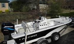 This is a very nice garage kept boat built for saltwater use but has never been used in saltwater.boat. It is the perfect fishing platform especially for windy lake conditions with a dry soft ride. Features: Beach protector, on board 3 bank battery