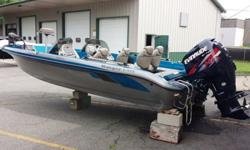 2005 Ranger Dual Console 619VS Fisherman packaged with 2012 Evinrude Etec 200 High Output and 2007 Evinrude/Johnson 9.9 Four Stroke Kicker Motor on Panther Power Trim BracketEquipment and options included:Dual console with passenger side console storage4
