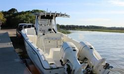 ,Sea Boss 255CC Center Console Walk Around. Twin Johnson 150 Salt Water Edition outboards. Boat has all the standard equipment including deck wash pump/hose, wells, many storage lockers, aluminum rigging with like new blue canvas. All plastic is in great