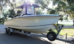Sea Boss 255CC Center Console Walk Around. Twin Johnson 150 Salt Water Edition outboards. Boat has all the standard equipment including deck wash pump/hose, wells, many storage lockers, aluminum rigging with like new blue canvas. All plastic is in great