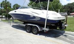2005 Sea Ray 270 Sundeck, a 27' bow rider powered by a 320 horsepower 6.2L Mercruiser stern drive, and a 2012 Road KIng tandem axle aluminum trailer w/brakes. The sale includes the Sea Ray Sundeck, the Mercruiser power package, and the trailer all shown