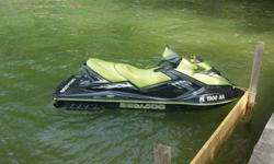 Two 2005 seadoo rxt skis both black and green having normal riding scratches. No hull damage. Both less than 100 hrs on them both. Both have had 100hr service done. Both run great and look great just no time to ride. Trailer has new springs bearings and