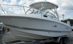 2005 Wellcraft 252 Coastal is fair condition. Powered with twin Johnson 140 four stroke motors. Equipped with a cuddy cabin which includes v-berth, porta potty and sink. Standard gauge package, livewell, hardtop, a dual axle aluminum trailer is included