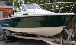ONLY 5 HOURS!!!This boat was purchased NEW in April 2006. It has less than 5 hours on it... that's right, only 5 hours!!!! For all intents and purpose, this boat is as close to BRAND NEW as it gets! Karavan galvanized trailer with brakes (just redone).