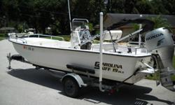 STANDARD EQUIPMENT? Bilge Pump (500 gal.) Rod Holders (8) ? Live Well (18 Gal.) ? Fuel Tank with Fuel Fill (28 Gal.) ? 70 QT Flip Flop Cooler Seat with Cooler Frame2006 CAROLINA SKIFF1965DLX Center Console with2006 HONDA 75 hp FOURSTROKE MOTORExcellent
