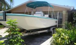 23 ft.Everglades Bay Flats boat.If your looking for a Great,economical,stable,flats or bay boat here it is.This is a turn key rig,turn the key and go.This is a simi custom built boat,the cap was custom built for me,one of a kind boat.The engine is like