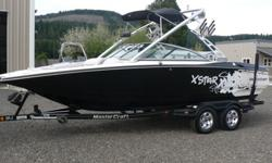 Arguably the best wakeboard boat on the market! The X-Star is one of the most popular boats for a reason. This 22' boat has a wide beam and is rated for 12 people. It is powered by the 350HP MCX V8. The hour meter shows 720 hours, but the boat is in
