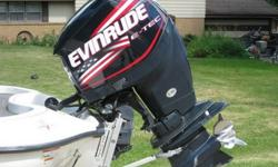 IT IS EQUIPPED WITH A 2006 EVINRUDE ETEC 225 ..THE MODEL NUMBER IS E225DHLSDF...THIS MOTOR WAS JUST REBUILT WITH A BRAND NEW POWER HEAD---0 HOURS ON IT!! INSTALLED POWERHEAD, REPLACED FUEL INJECTORS 2 & 4, INSTALLED A NEW WATER PUMP & ALSO INSTALLED A NEW