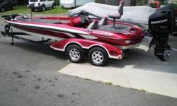 2006 Ranger Z21 Comanche Single Console Fiberglass Bass Boat. Powered with a 2006 Mercury 225HP Pro XS Direct Injection Outboard Motor. Motor is equipped with power trim operated in four different locations, directly on engine, gear shift lever, steering