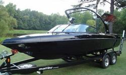 Type: Ski/wakeboard .Engine type: Inboard V-Drive .Use: Fresh water .Length (feet): 21.0 .Engine make: Indmar .Primary fuel type: Gas .Engine model: 5.7L .Hull material: Fiberglass .Trailer: Included . I customized the color scheme and had them leave off