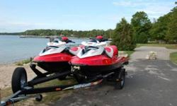 """(2) Pair of father and son sea-doo watercraft on a two place double trailer. In outstanding condition as they have not been """"beached"""" or abused. Maintained religiously and garage kept means they are as nice as you will ever find. Only 46 hours on each."""