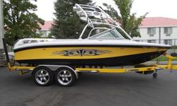 Looking good on and off the water. This Nauti-Bee 2007 Super Air Nautique 210 Team Edition will turn heads. Nicely loaded for a great day/week on the water. Package includes theater seating, tower, tower speakers, bimini, swivel wakeboard racks, snap on