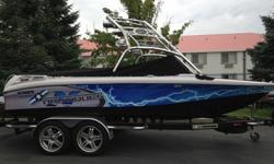 Looking good on and off the water. This 2007 Super Air Nautique 210 Team Edition will turn heads. Nicely loaded for a great day/week on the water. Package includes theater seating, tower, tower speakers, bimini, swivel wakeboard racks, snap on bow and