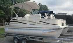 This 17 foot Sweetwater fishing pontoon is in awesome condition inside and out. It comes loaded with cool options for a great day of fishing or just hanging out on the lake. It includes a full cover, huge bimini top with boot cover, stereo with all the