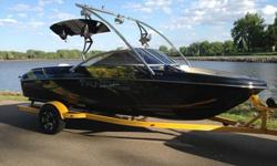 This is the sickest boat on the water.-5.0 L V8 MPI engine-New wrap by Octane Ink in Tea, SD-Aerial Assault tower, with racks for 4 wakeboards ($1,400, uninstalled), folds down for easy storage-Aerial bullet speakers with integrated lights ($400), and