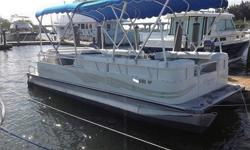 "Some might describe it as a ""back to basics"" boat, as its design emphasizes those things most important to the pontoon lifestyle: uncluttered deck space and ease of operation. The standard package provides all the requisite amenities for a day afloat."