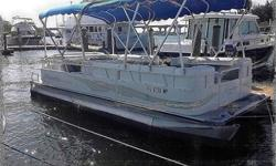 with a 32?, elliptically shaped center tube with lifting strakes. That central tube also provides the real estate for an enormous ski locker. For more info, read Bennington 2575 QCW Pontoon Boat Review: Top Shelf Fun or watch our 2014 Bennington 2575