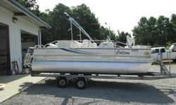 Ok, here we go with a nice pontoon...I bought this boat as a repo.... IT ONLY HAS 60 hours.......This boat comes with a full play pen cover and it is very nice..... this boat was left outside without the cover on it... and it ruined the seats.... I just