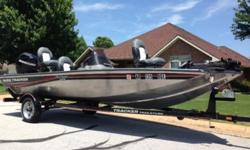 This Bass Tracker is in excellent condition! Only 14 actual hours!! This boat is set up very well for fishing. Comes with fish/depth finder, 2 livewells, two more aerated bait tanks/live wells, rod box, lots of storage, cup holders, 46lb thrust trolling