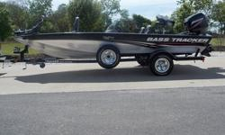 THIS 2008 BASS TRACKER PRO TEAM 175 30TH ANNIVERSARY BLACK AND SILVER BOAT WITH MATCHING TRAILER AND SPARE. THIS BOAT IS POWERED BY A 50HP MERCURY 2 STROKE OIL INJECTED MOTOR ( 20 hours ).INTERIOR: THIS BOAT IS AS CLEAN AS YOU WILL EVERY FIND ONE. ALL