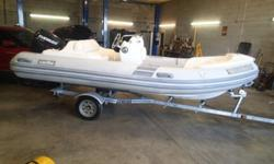 2008 Caribe DL15 Inflatable boat with 60 hp Evinrude engine. The boat runs great. The boat sustained storm damage to the boat. The engine cover on the engine is busted, but is above water level could use as is if you ;ike. The rear seat is ripped, the