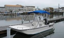 It is the 17 foot DLX model which is a wide body and has deeper sides than the J series.The boat has a blue canopy top and a rod holder mounted in the front. Boat will come with all Coast Guard Equipment, anchor, life jackets, ready to go.The Mercury
